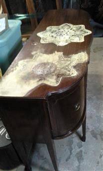 """Sideboard-With-Patterned-Water-Damage"""